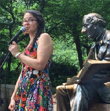 MaryAnnSchmidt telling stories at the Hans Christian Andersen statue